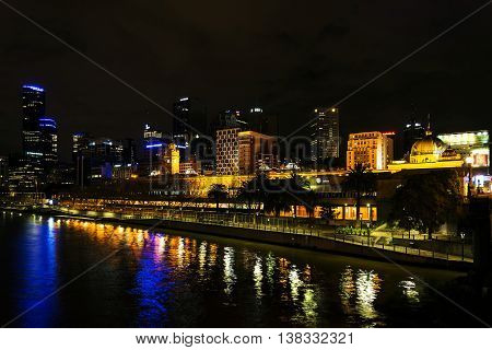 central melbourne city river side modern urban skyline at night in australia