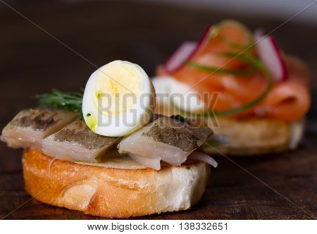 Sandwiches with salted fish and fresh vegetables