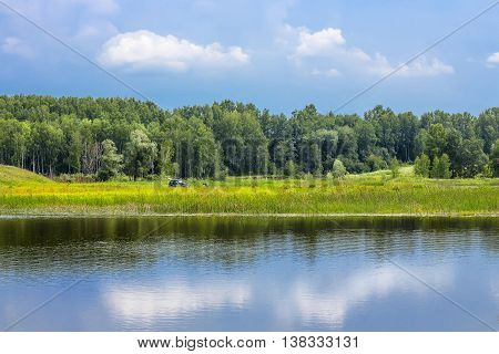 Russian summer landscape on the river. River Miletus Novosibirsk region Siberia Russia