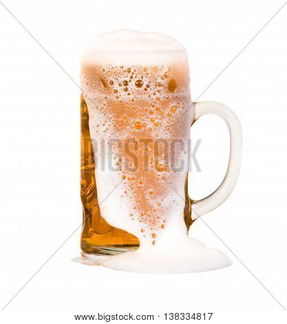 light beer mug poured to the brim through which flows foam