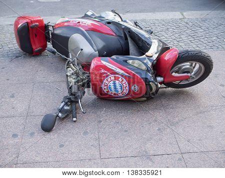 BERLIN GERMANY - JULY 6 2016: Failure: Bayern Munich motorcycle fallen down