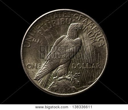 US silver 1925 year dollar with eagle isolated on black closeup macro shot top view