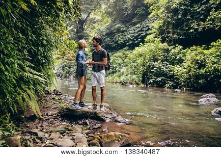Loving Couple Standing By A Mountain Stream