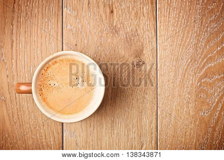 cup of espresso coffee on wooden table