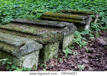 Old stone coffins in the woods selective focus