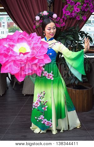 Beautiful Asian Girl In Traditional Chinese Dress And Floral Parasol