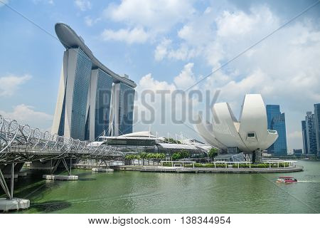 SINGAPORE - MAY 6 2016 : Cityscape of Singapore Skyline and Helix bridge at Marina Bay Sands one of famous tourist attraction in Asia.