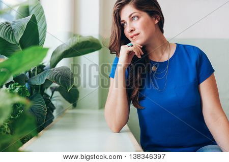 Attractive Young Woman Daydreaming