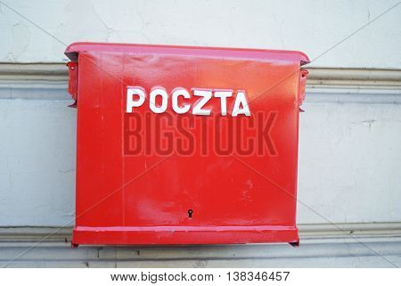 Mailbox hangs on the wall in Poland