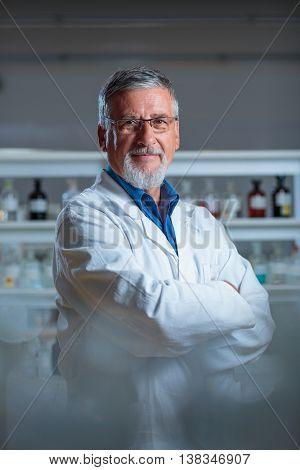 Senior chemistry professor/doctor in a lab (color toned image)