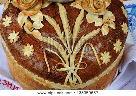 Traditional Ukrainian festive loaf for meeting guests. This sacred ritual bread which is always done artistically and aesthetically decorated round