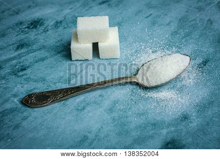 Spoon with granulated sugar. Sweet food photo