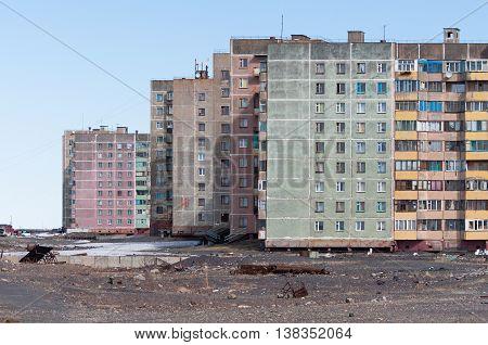 Multi-storey residential building in Norilsk. House on pile foundation, built on permafrost.