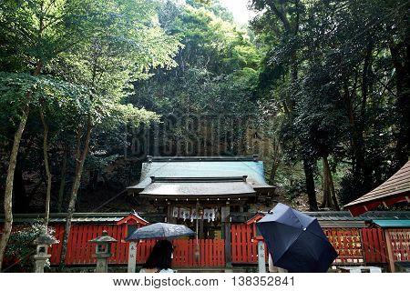 Ladies standing in the rain at a Shrine in Arashiyama, Kyoto, Japan