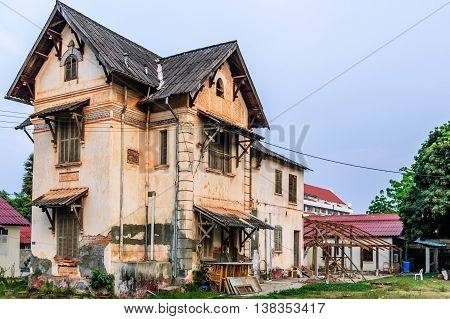 Vientiane Laos - March 15 2013: Derelict house in Vientiane the capital of Laos