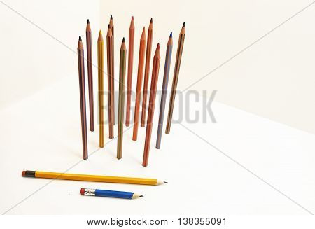 Colored pencils located vertically. Isolated on white background.