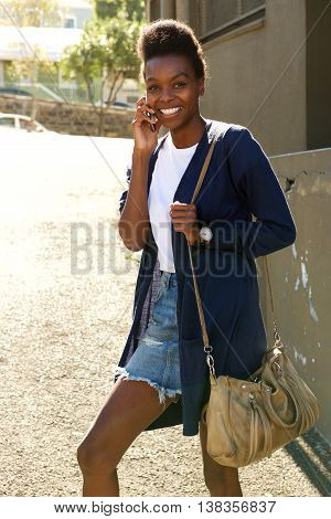Beautiful Young Black Woman Outdoors Using Cellphone
