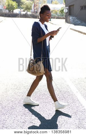 Young African Woman Using Mobile Phone On The Street