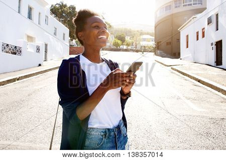 Cheerful Young Woman On The Road With Mobile Phone