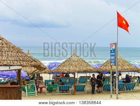 People Lying On Sunbeds At China Beach In Da Nang