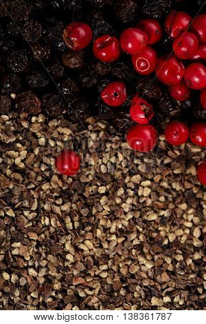 whole and crashed  black and red peppercorns background
