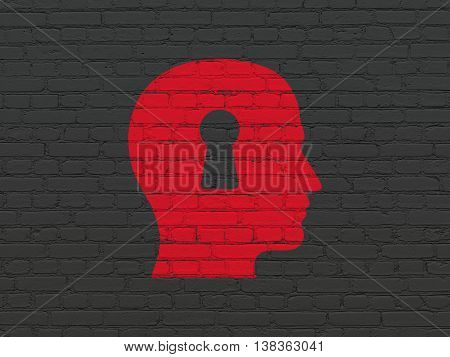 Studying concept: Painted red Head With Keyhole icon on Black Brick wall background