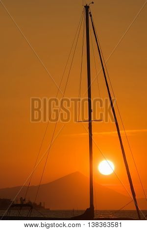 Sunset view framed from inside the mast of a sailing boat.
