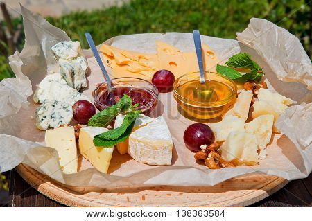 group of cheese on the plate snack