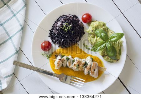 Top View Of Shish Kebab Or Shashlik With Red Rice, Yellow Pepper Sauce And Guacamole