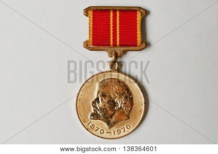 Soviet Medal For The Valiant Work 100 Anniversary Of Lenin's Birth On White Background