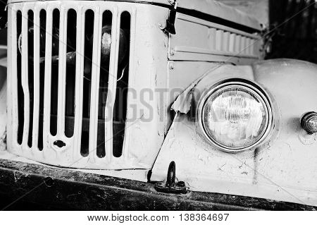 Retro Car Headlight With Radiator Grille. Black And White Photo