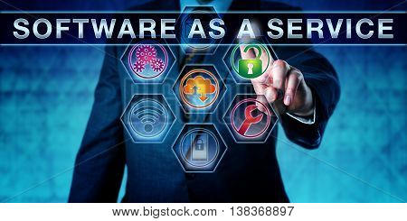 Developer is pressing SOFTWARE AS A SERVICE on an interactive touch screen. Business licensing metaphor and concept for SaaS software distribution and service-oriented business computing.
