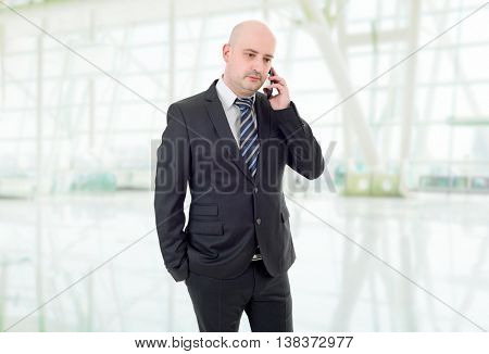 happy business man on the phone, at the office