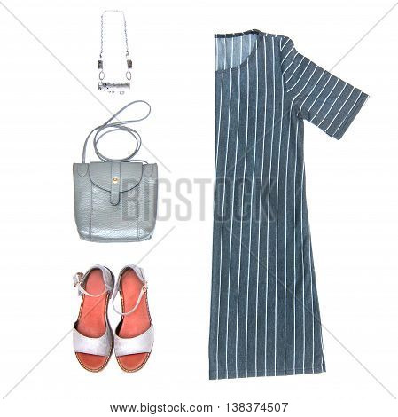 Fashion still life Womens clothing on white background Grey striped dress necklace purse shiny lace-up Top view