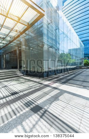 empty pavement and modern building in city