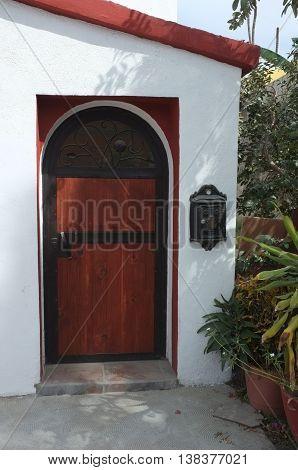 Wooden door on white wall, San Jose del Cabo, Baja California Sur, Mexico