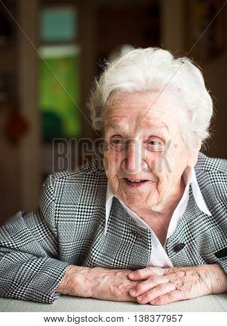 Portrait of a gray-haired elderly women.