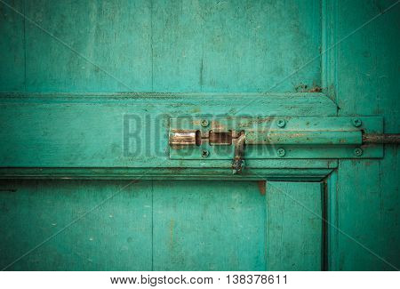 Old rustic door with old bolt with vignette style