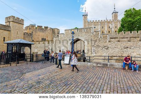 London UK - June 15 2016: detail of the Tower of London with the Gherkin in the back. The Tower of London is one of the countrys most popular tourist attractions protected as a World Heritage Site.