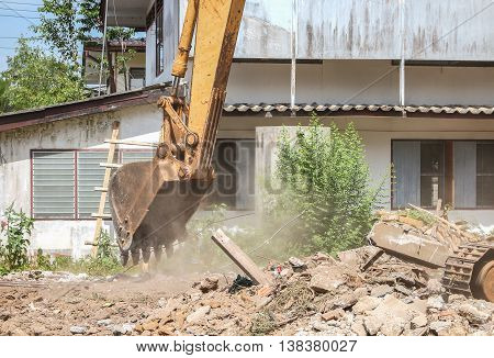 bucket Excavator selective focus, destruction in Work outdoor  construction,and  dust soil motion