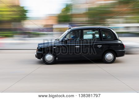Traditional London Taxi In Motion Blur