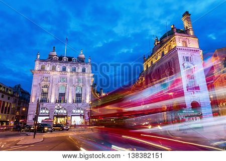 London UK - June 15 2016: Piccadilly Circus in London at night. Its status as a major traffic junction has made Piccadilly Circus a busy meeting place and tourist attraction