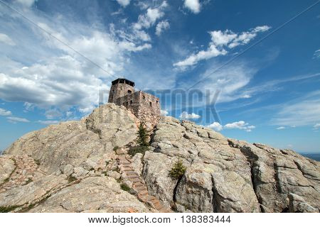 Harney Peak Fire Lookout Tower and stone step pathway in Custer State Park in the Black Hills of South Dakota USA