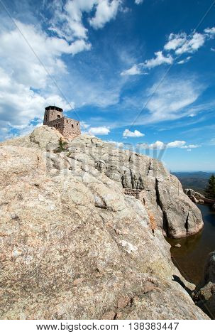 Harney Peak Fire Lookout Tower and pump house with small dam in Custer State Park in the Black Hills of South Dakota USA