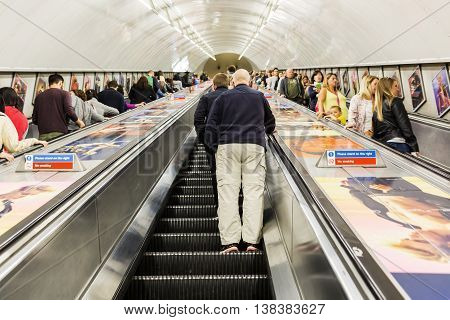 Busy Commuters On Elevators Of An Underground Station In London, Uk