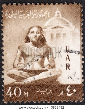 MOSCOW RUSSIA - JANUARY 2016: a post stamp printed in United Arab Republic (UAR) shows a sculpture of the seated scribe the series
