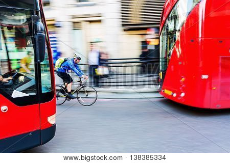 Cyclist In Motion Blur In The City Traffic Of London, Uk
