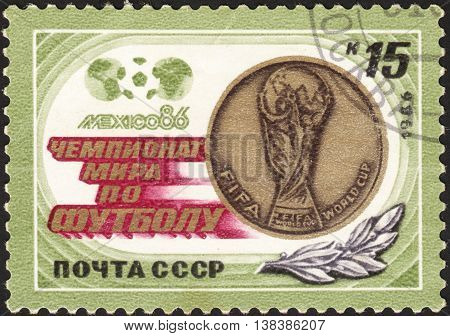 MOSCOW RUSSIA - DECEMBER 2015: a post stamp printed the USSR and devoted to the Football World Cup - Mexico 1986 circa 1986