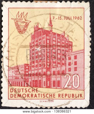 MOSCOW RUSSIA - JANUARY 2016: a post stamp printed in DDR shows an old building devoted to the 5th Baltic Week circa 1962