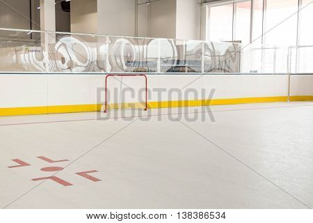 red line on hockey rink. Face off circle. modern empty rink. hockey goal. Front view from ice